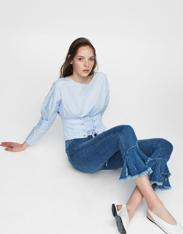 Ruffled flared jeans