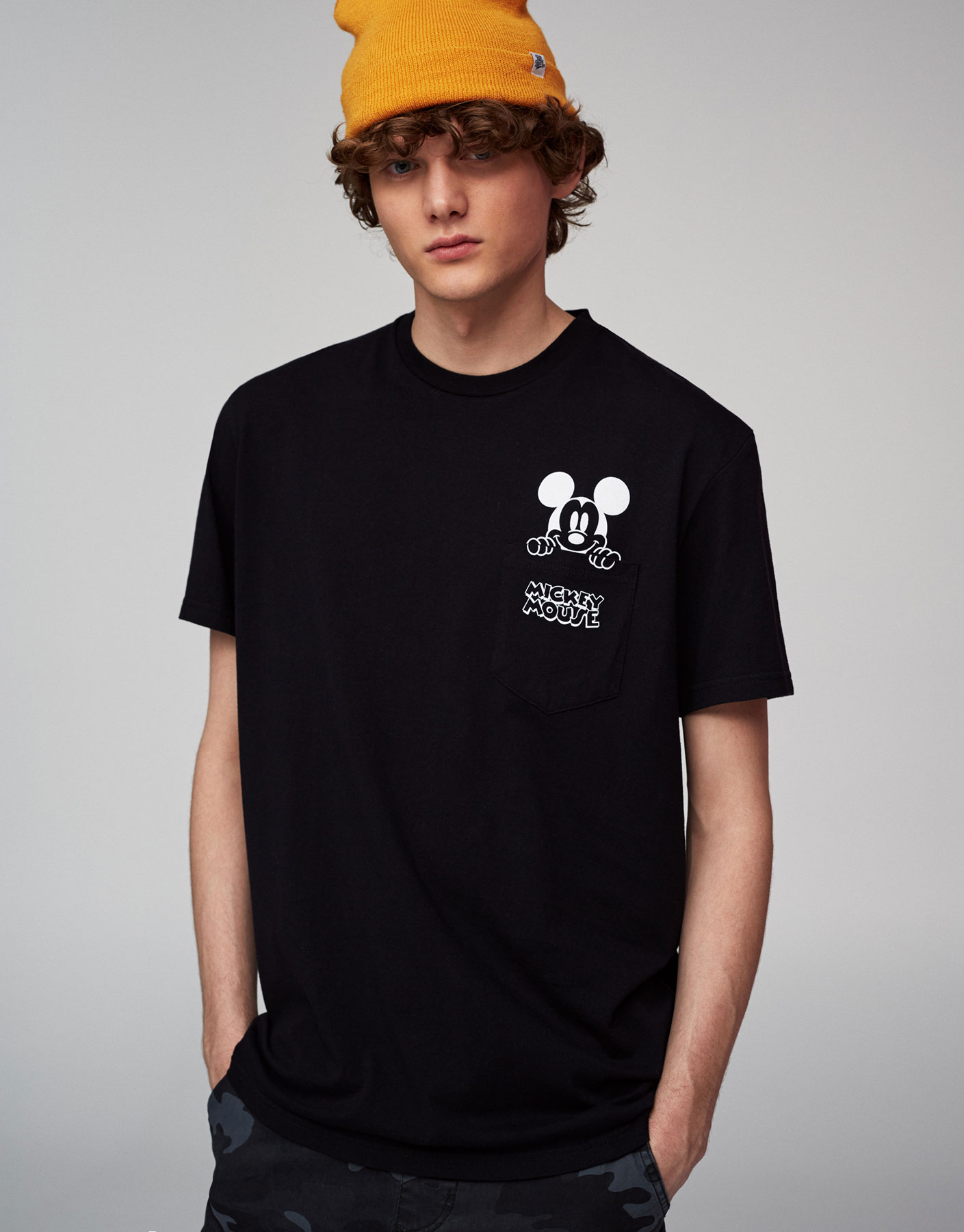 T-shirt with Mickey Mouse on pocket