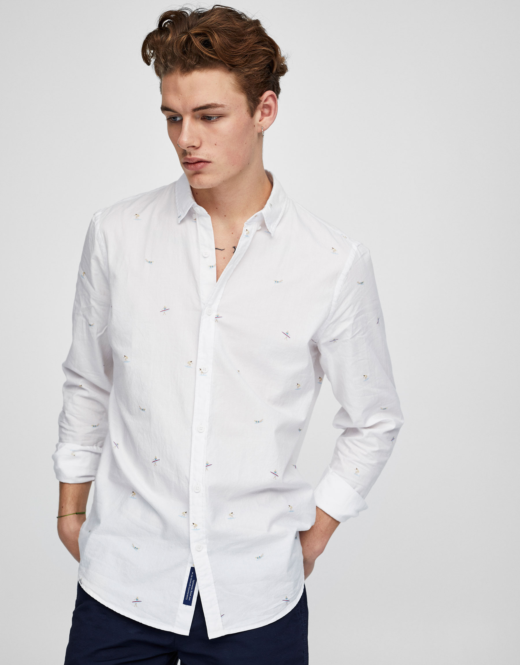 Surfers all over print white shirt