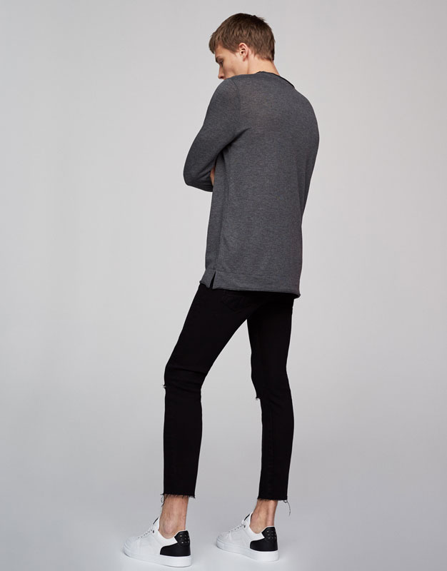 Round-neck ripped sweater