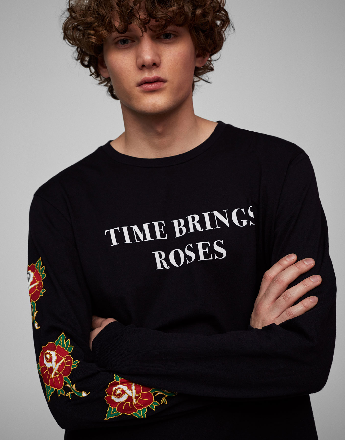 Sweatshirt with embroidered flowers on sleeve
