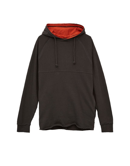 Hooded sweatshirt with contrasting orange
