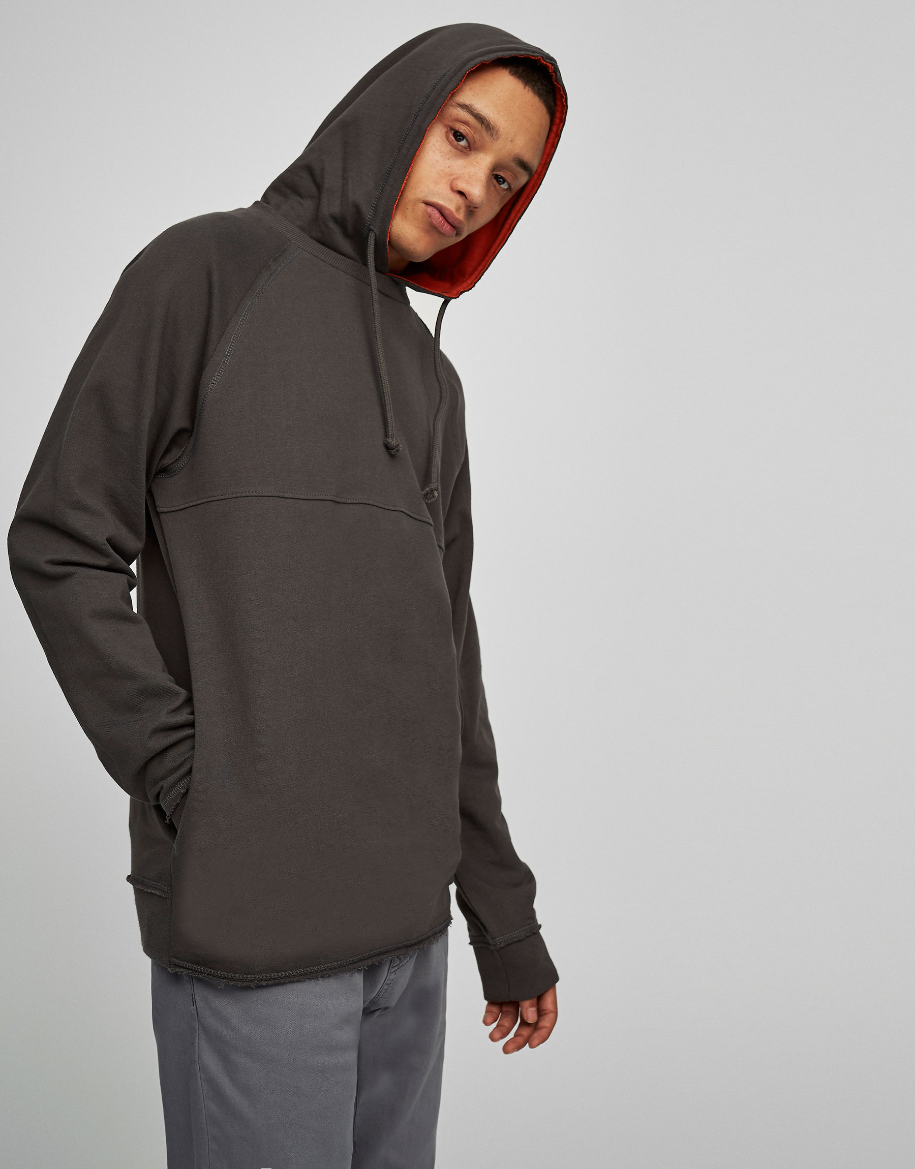 Hooded sweatshirt with contrasting orange