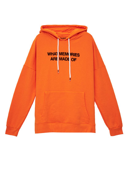 Orange hooded sweatshirt with slogan