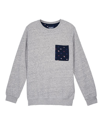 Sweatshirt with contrasting printed pocket