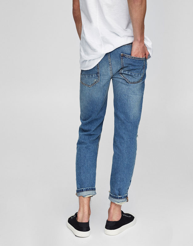 Cropped slim fit tapered jeans
