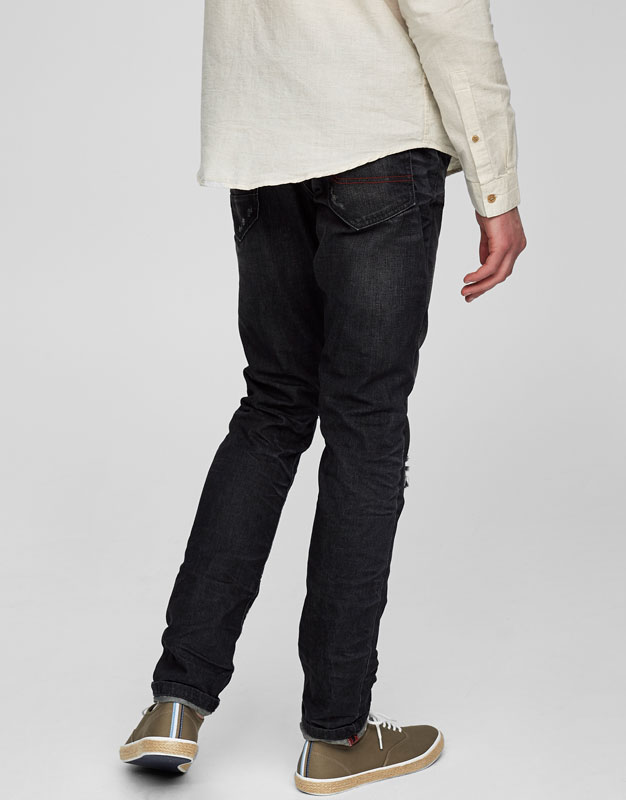 Slim fit faded ripped jeans