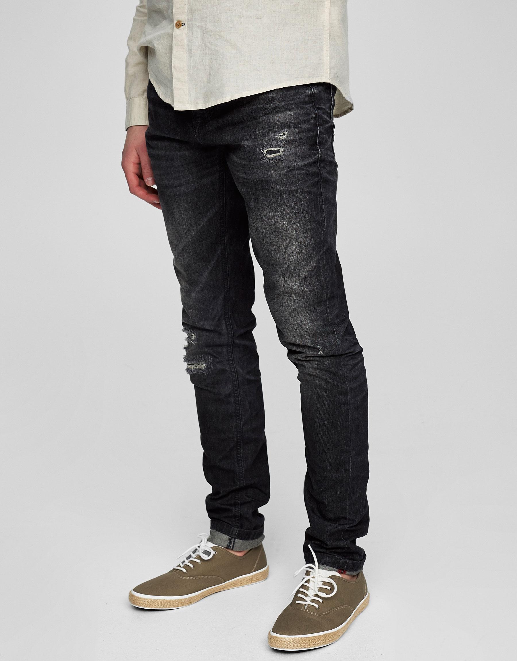 Jeans lavado slim fit cortes