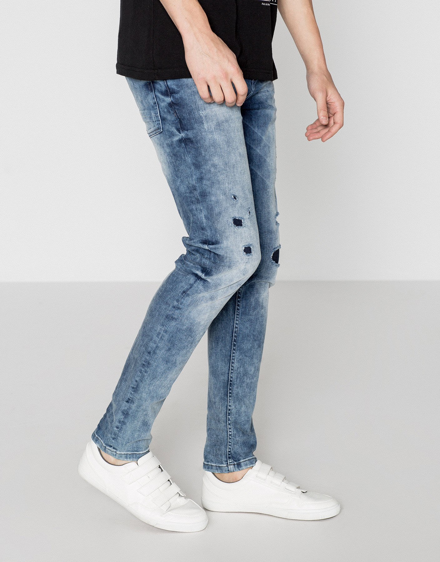 Big skinny fit jeans with rips and patches