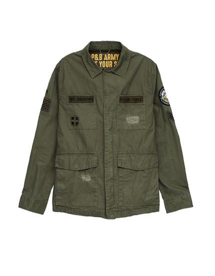 Military safari jacket with rips and patches