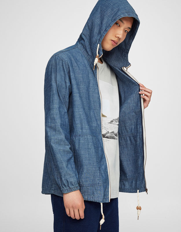 Denim jacket with hood and zip fastening