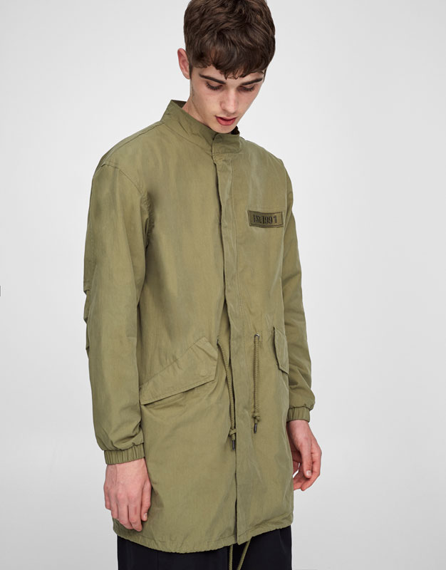 Military parka with embroidered back