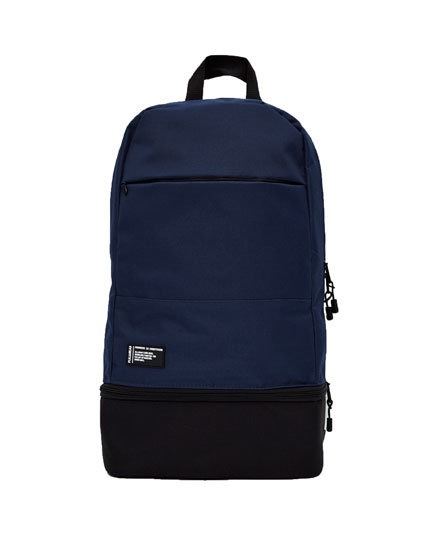 Sports backpack with bottom pocket