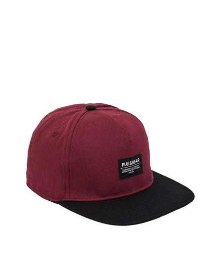 Burgundy cap with black visor
