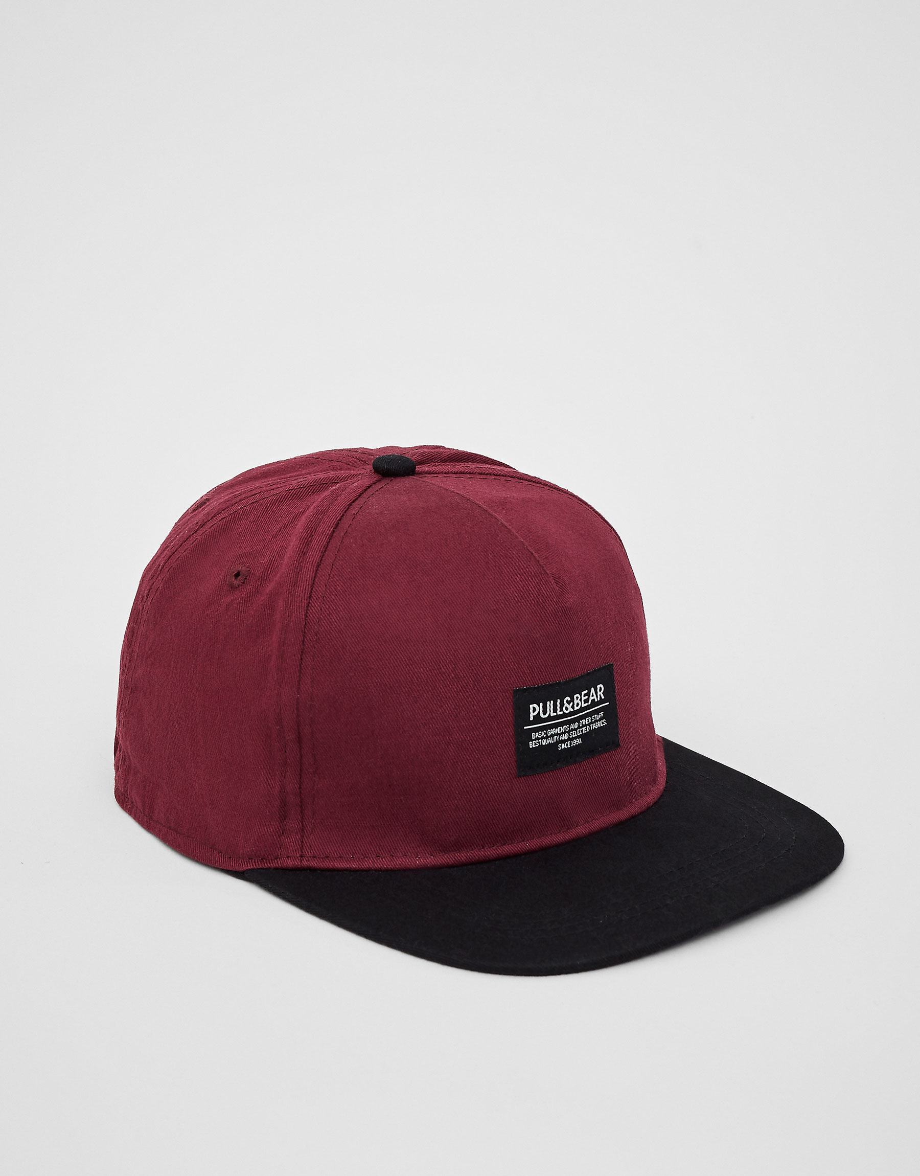 Burgundy cap with black visor