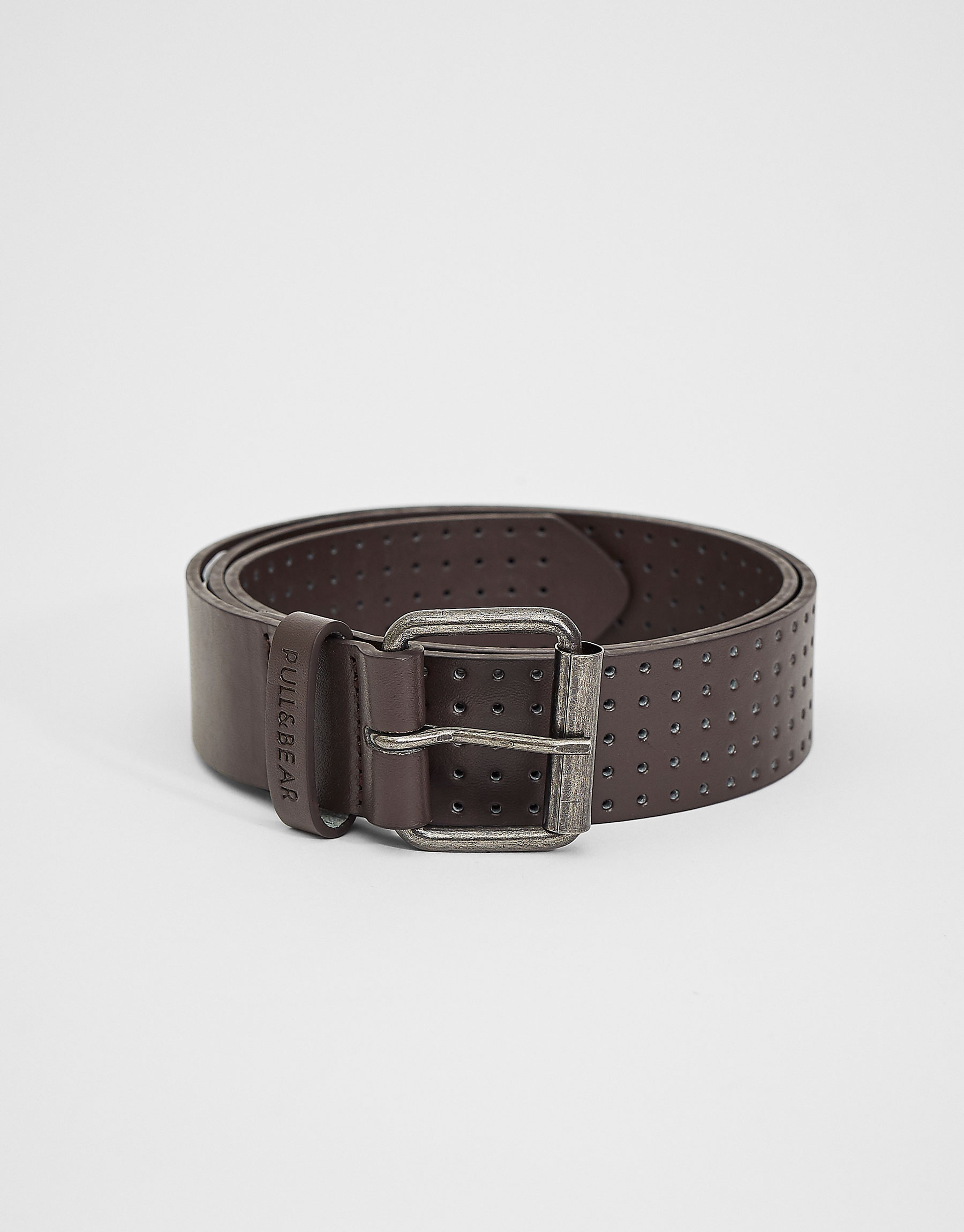 Belt with multiple perforations