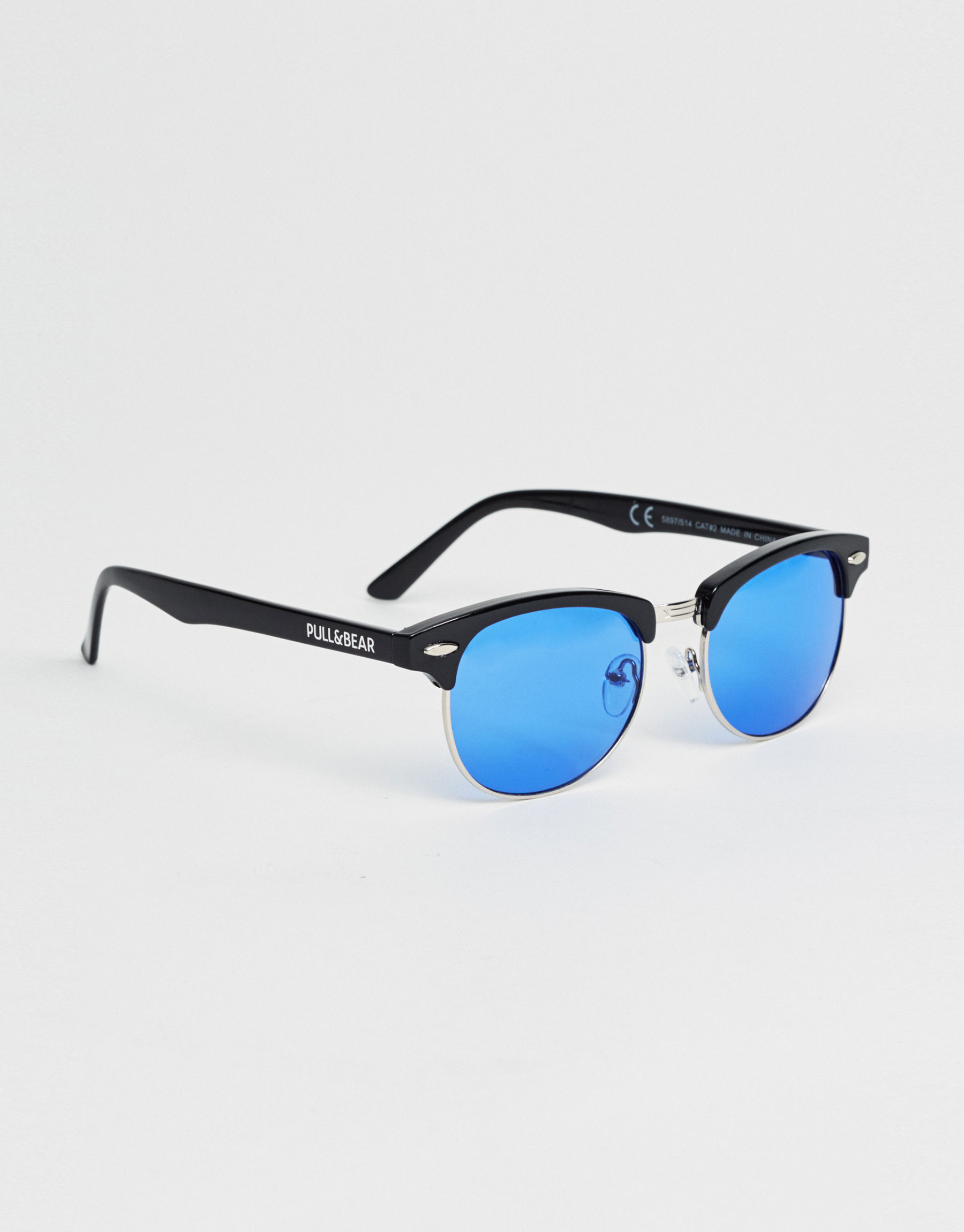Sunglasses with blue lens and retro frame