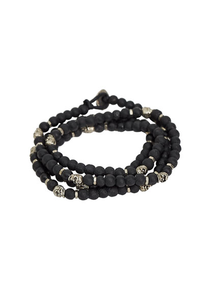 Bracelet with multiple black and silver-toned spheres
