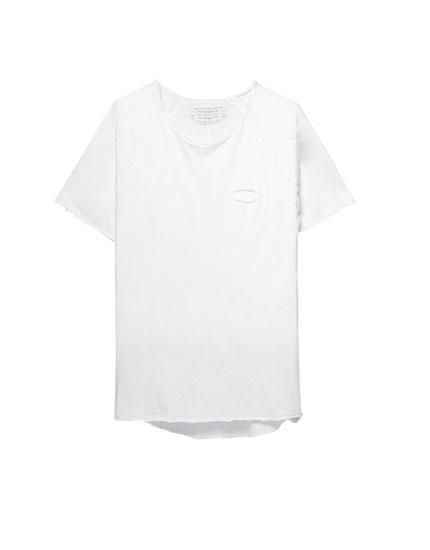 Camiseta manga ranglán bolsillo