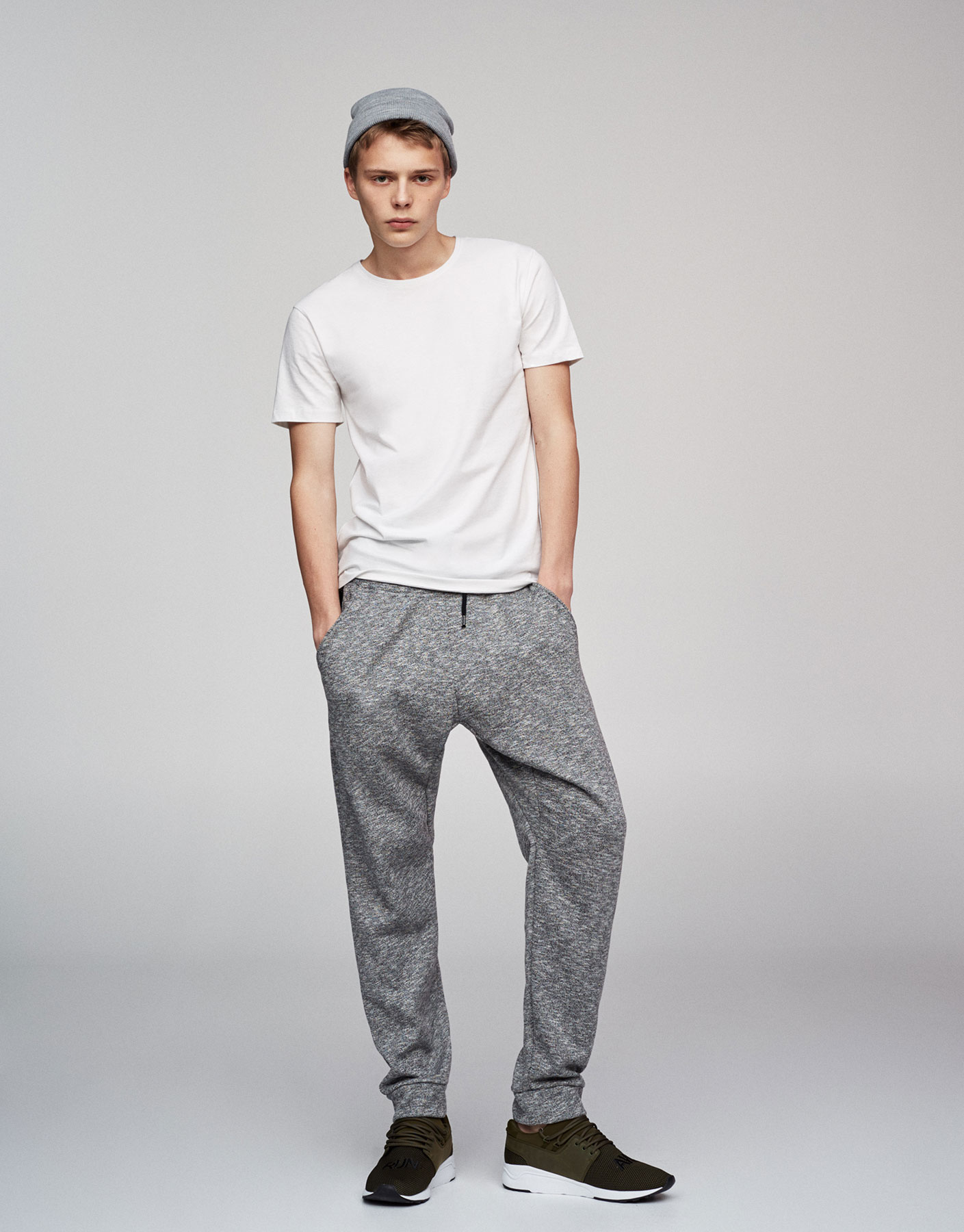 Baggy grey jogging trousers