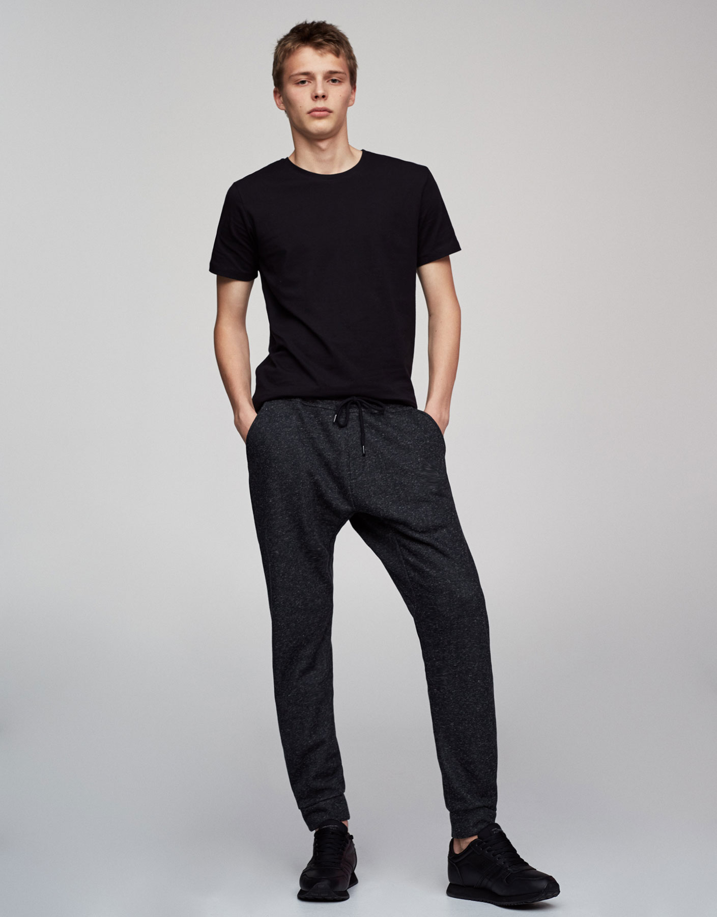 Baggy black jogging trousers