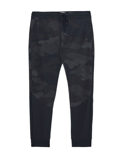 Camouflage print jogging trousers.