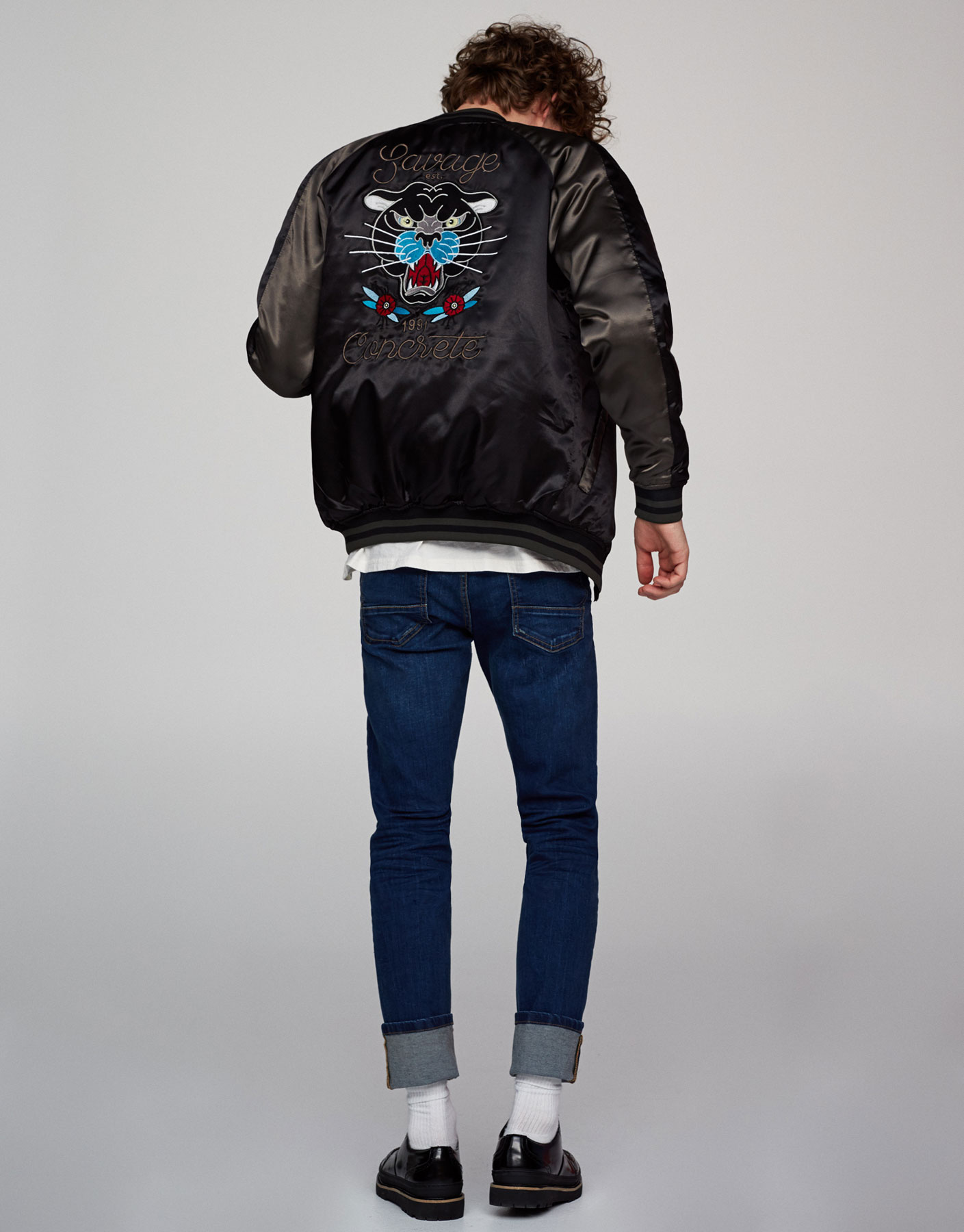 Glossy bomber jacket with embroidered back