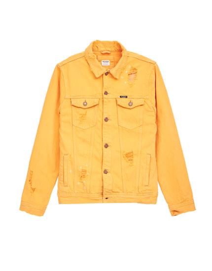 Orange denim jacket with rips