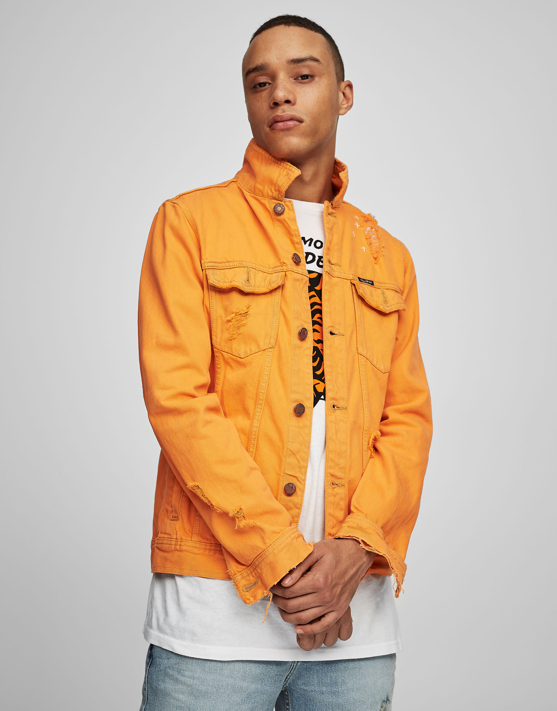 Orange denim jacket with rips