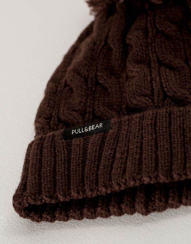 Cable knit hat with pompom