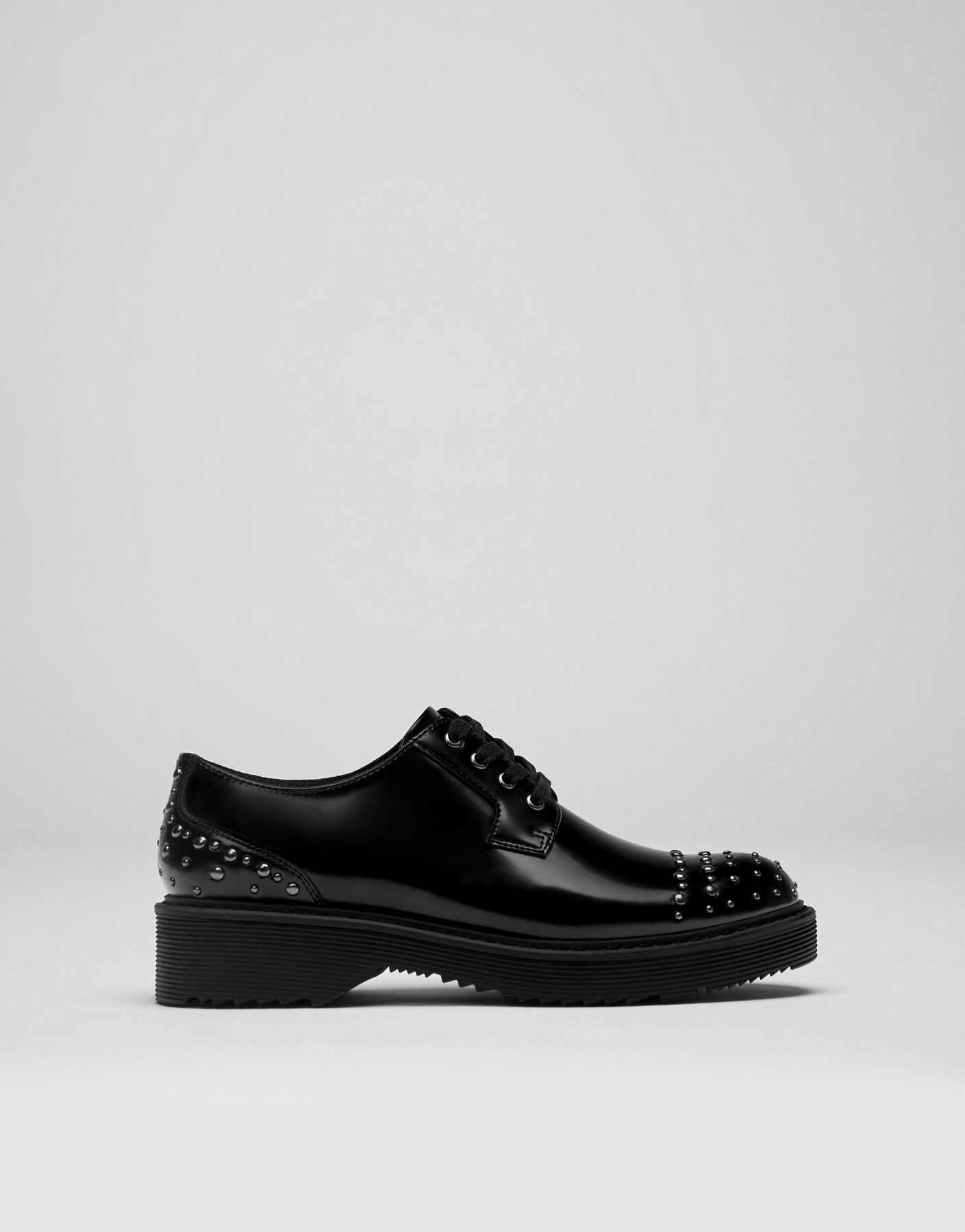 Studded antik bluchers. Stud detail. Lace-up fastening.