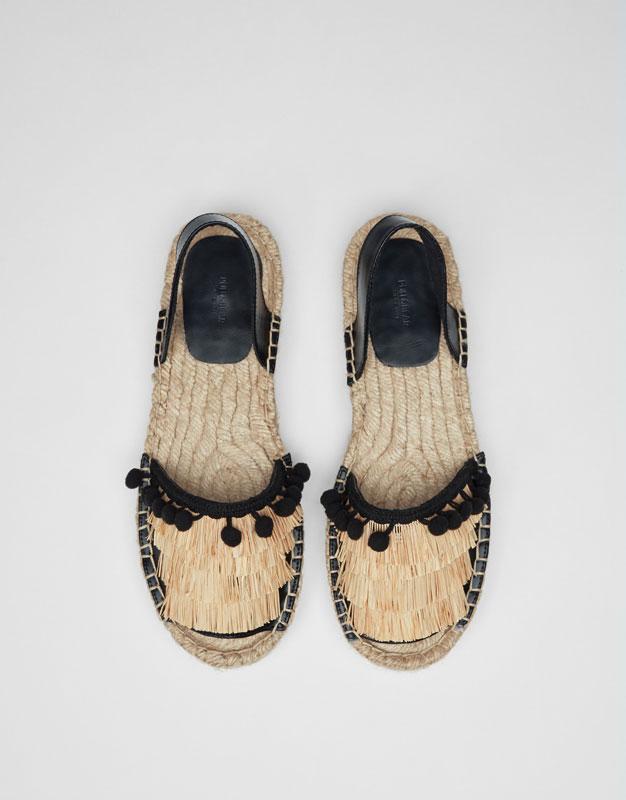 Black fashion espadrilles with tassels