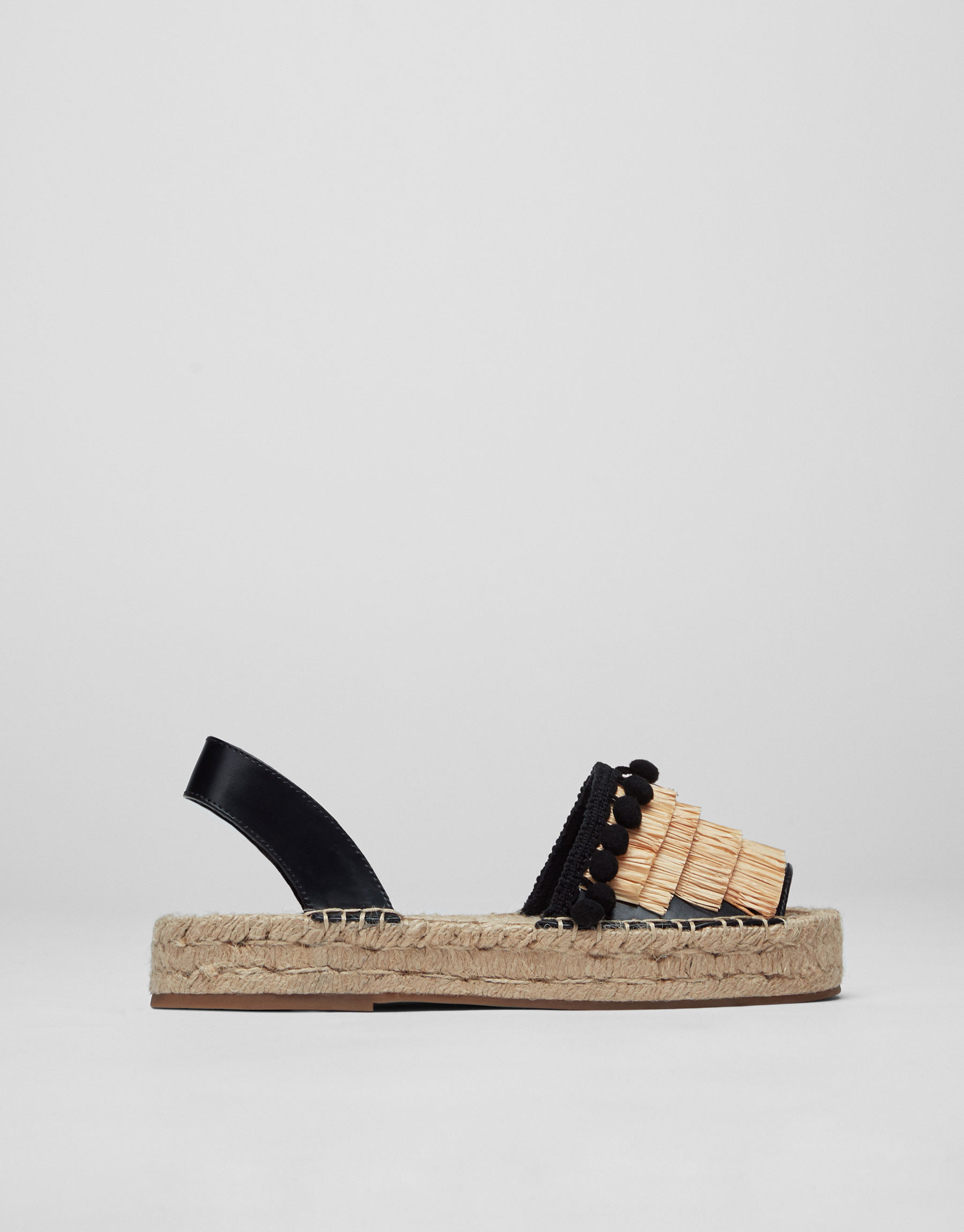 Black fashion espadrilles with tassels