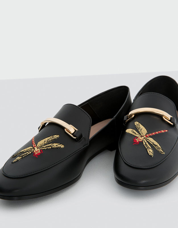 Golden buckle loafers