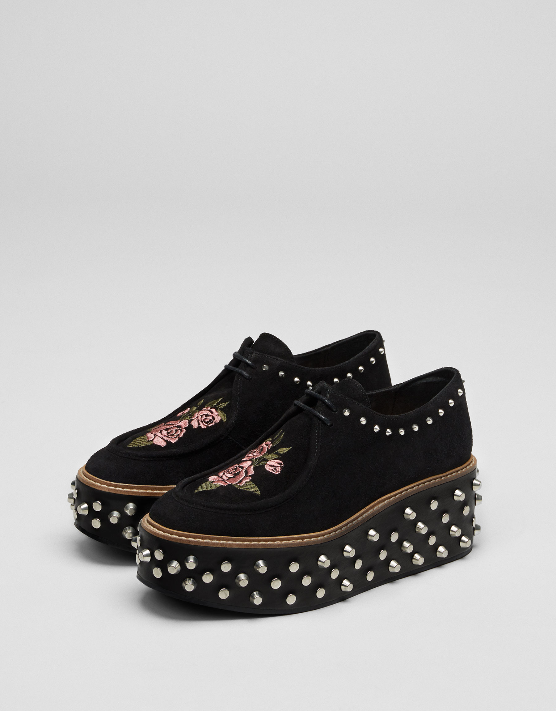 Chunky sole shoes with studs and embroidery