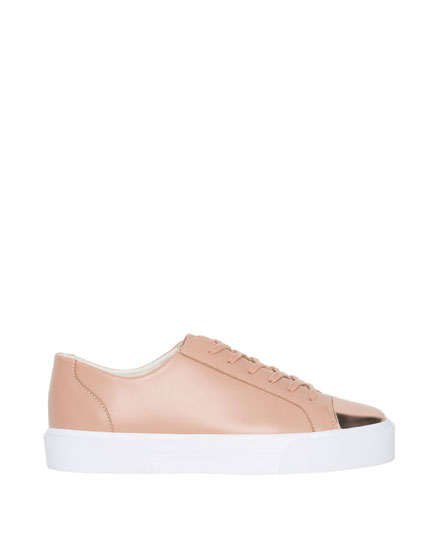 Plimsolls with metallic toe-cap