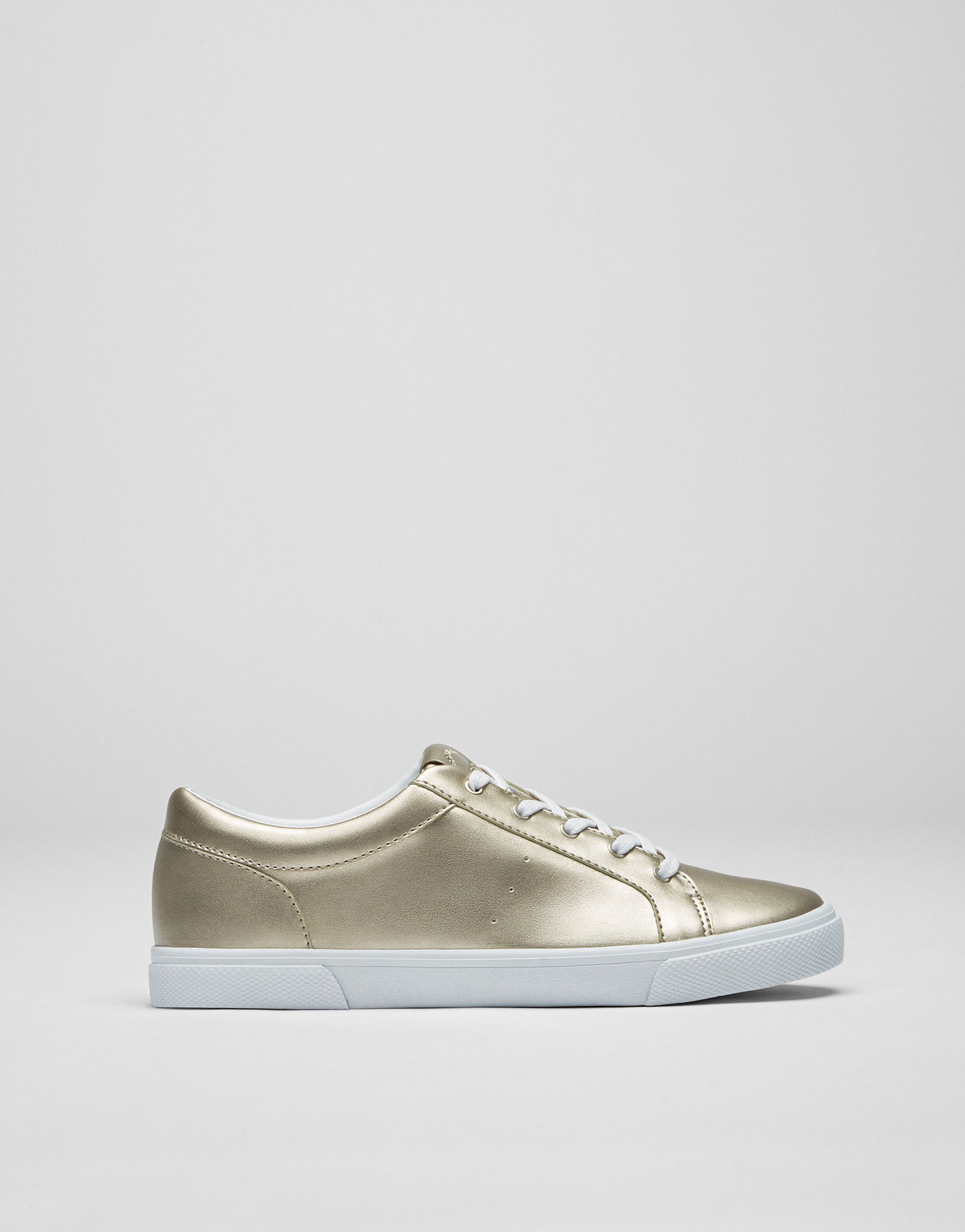 Basic golden metallic plimsolls