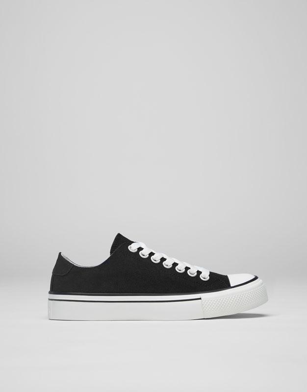 Black fabric plimsolls with toe cap