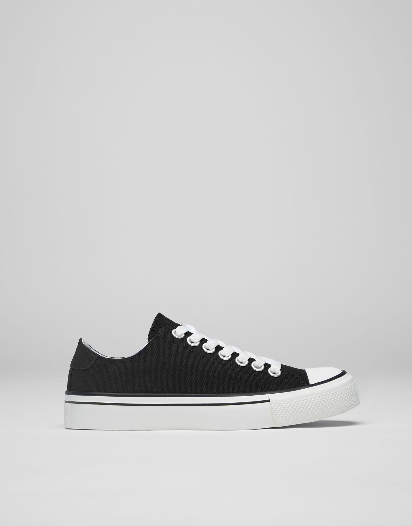 Black fabric plimsolls with toe cap