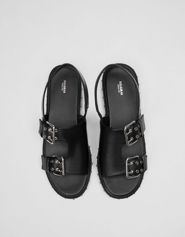 Sandals with studded outsole