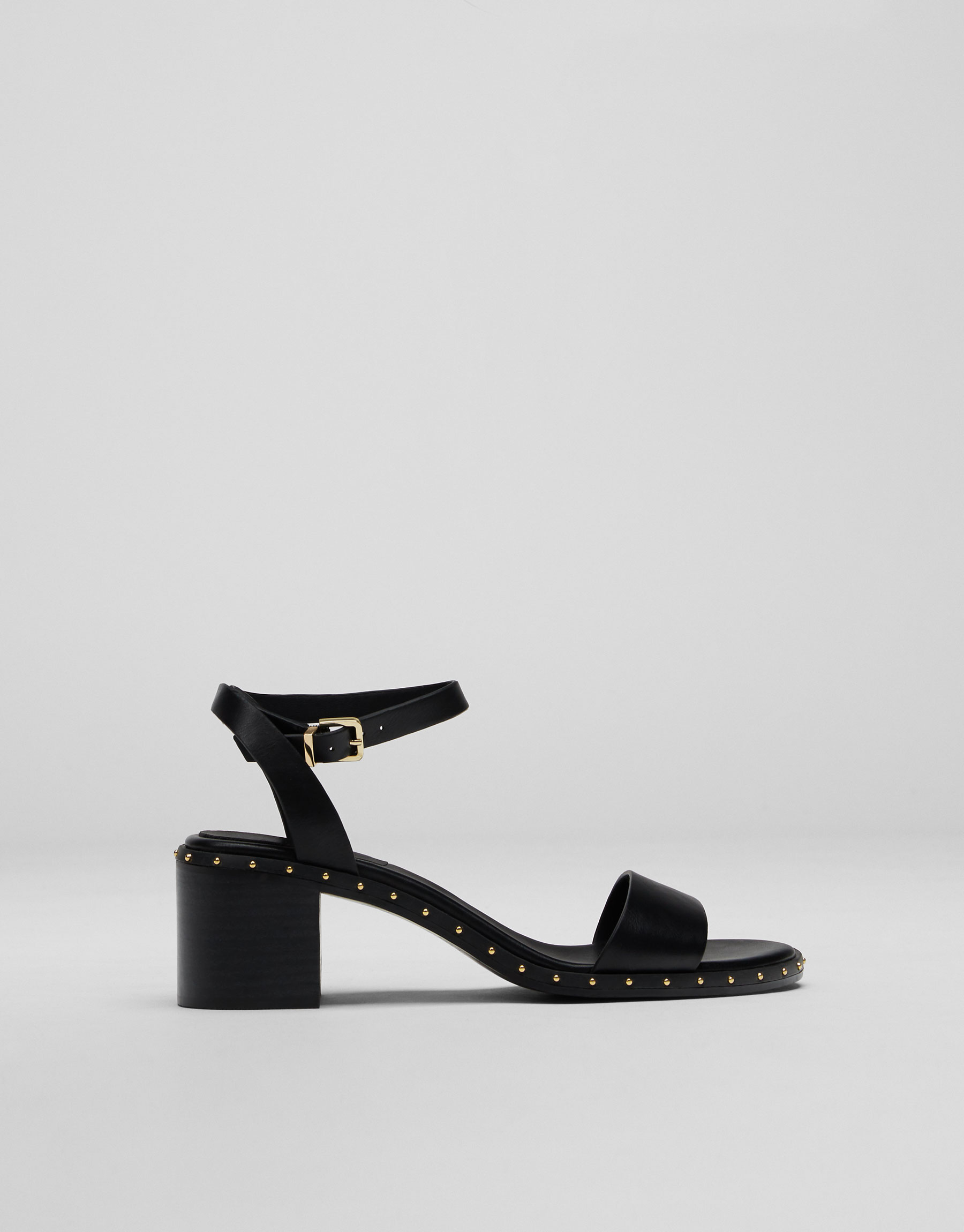 Mid-heel sandals with studs