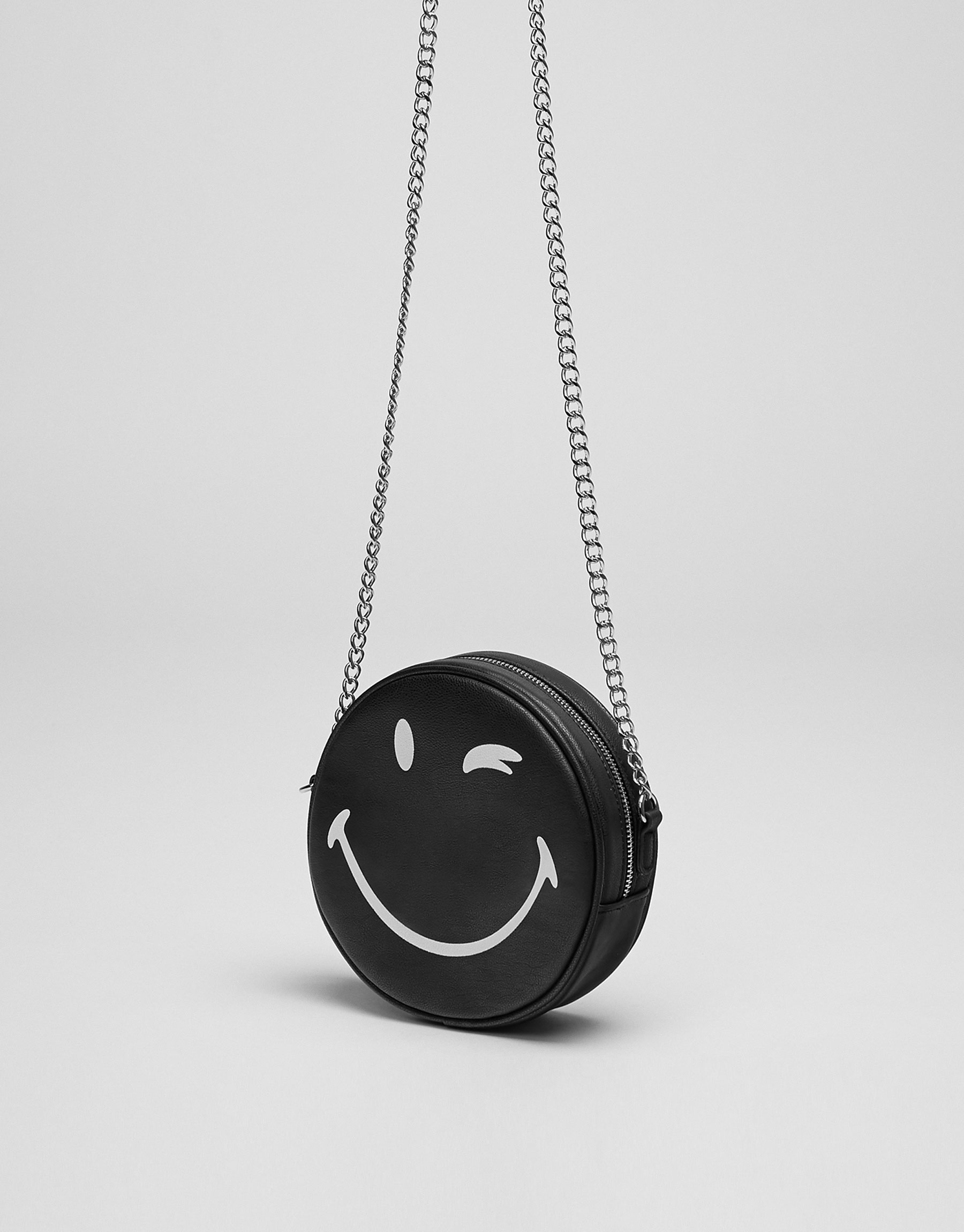 Mini black smiley face crossbody bag