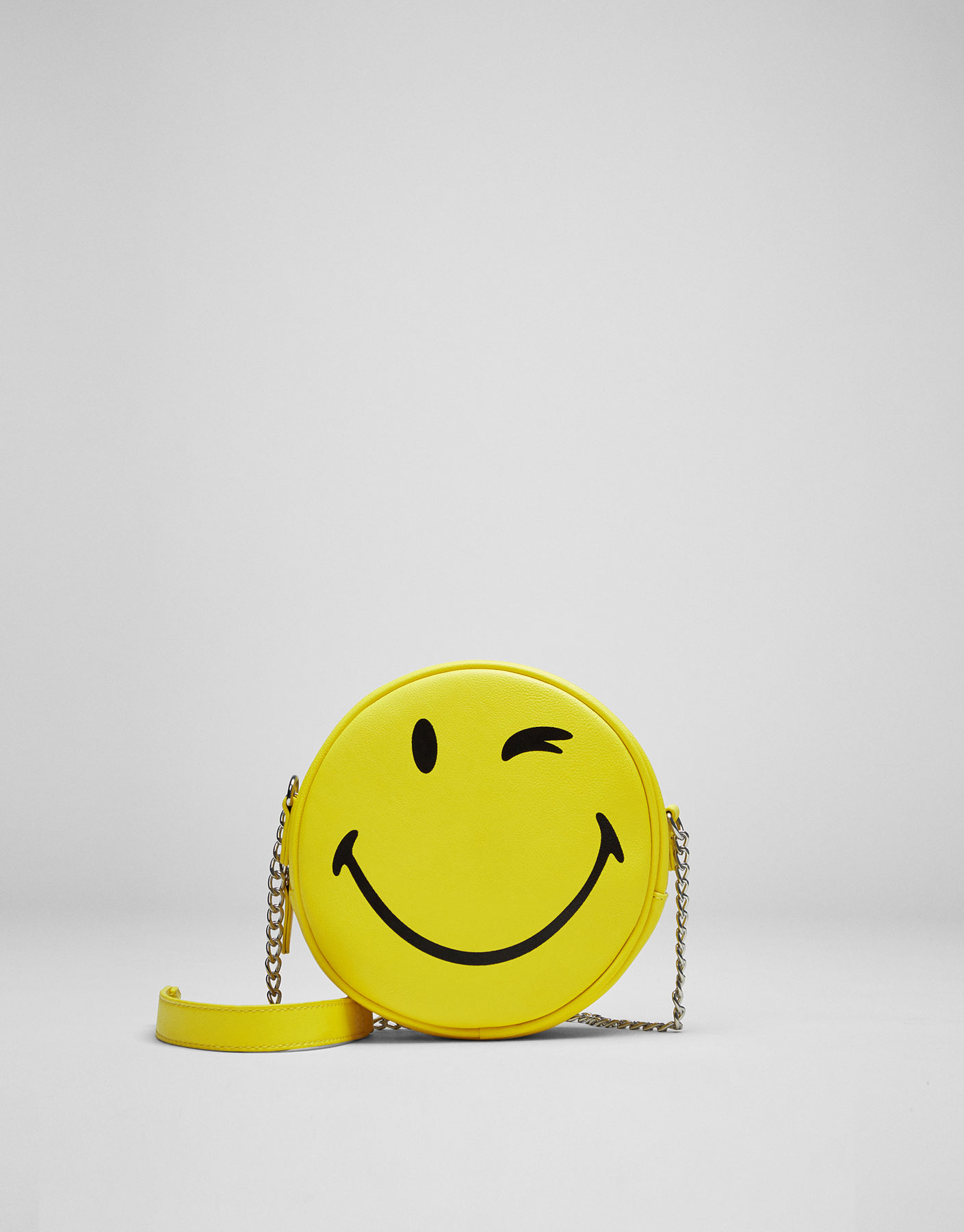 Mini yellow smiley face crossbody bag