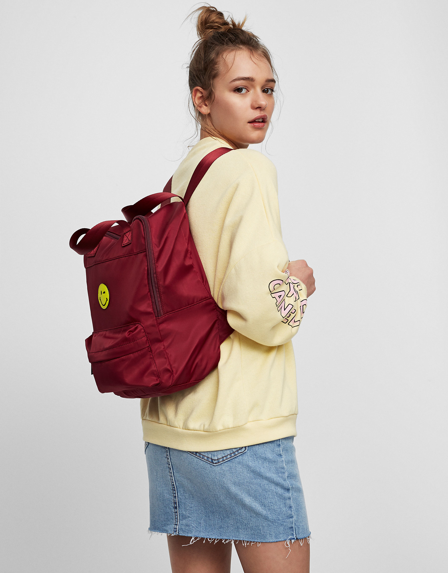 Maroon fabric Smiley Face backpack