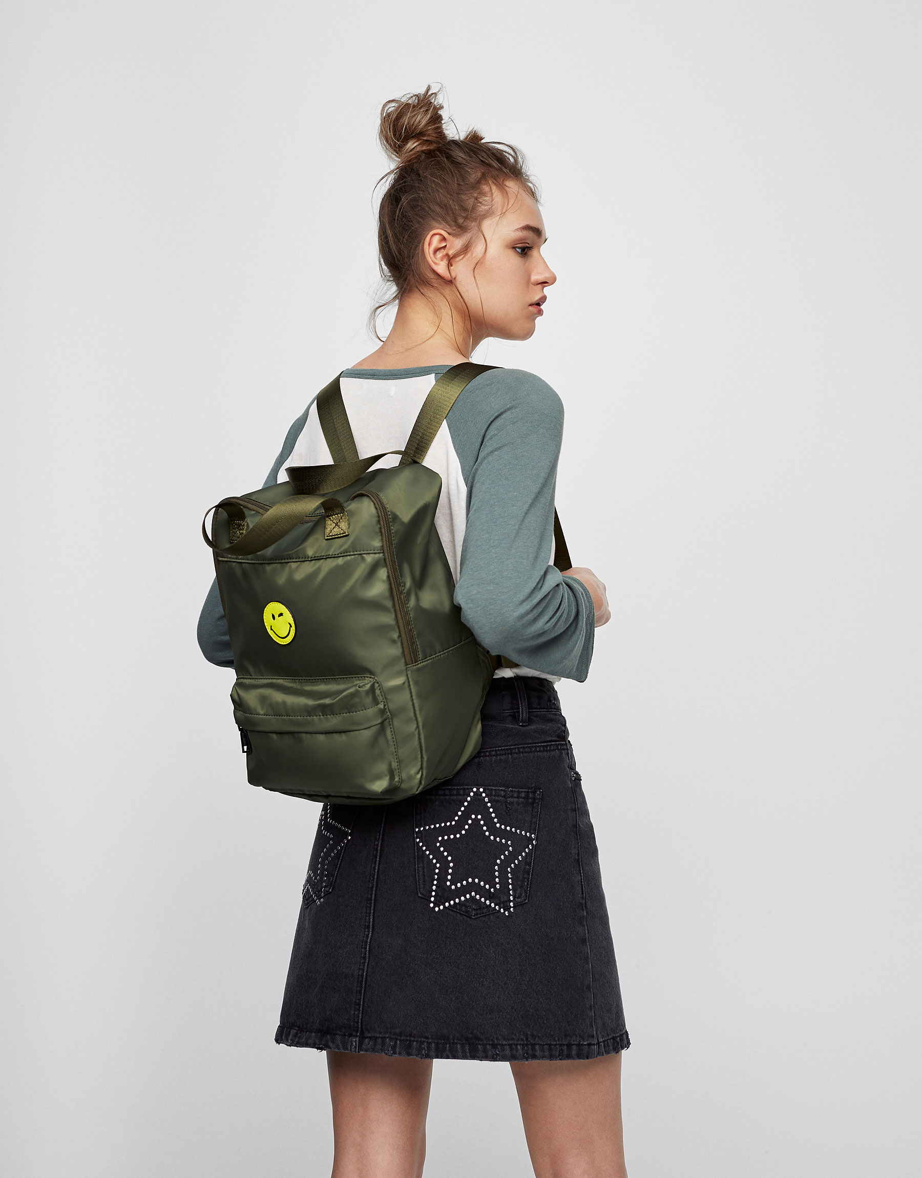 Green fabric Smiley Face backpack
