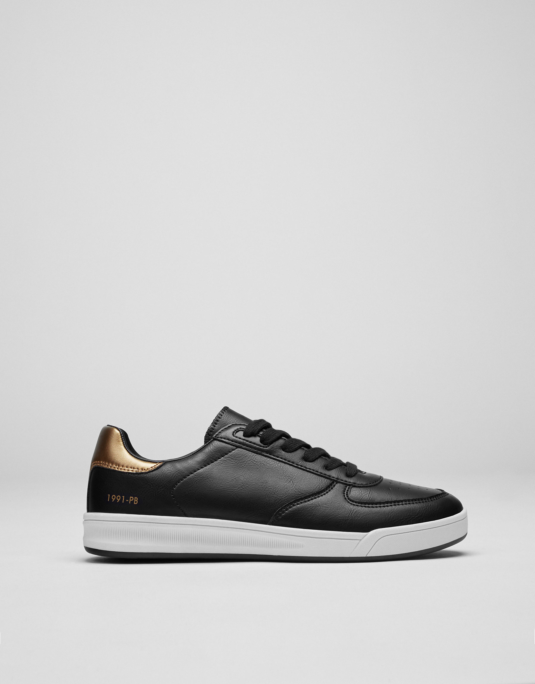 Plimsolls with golden detail