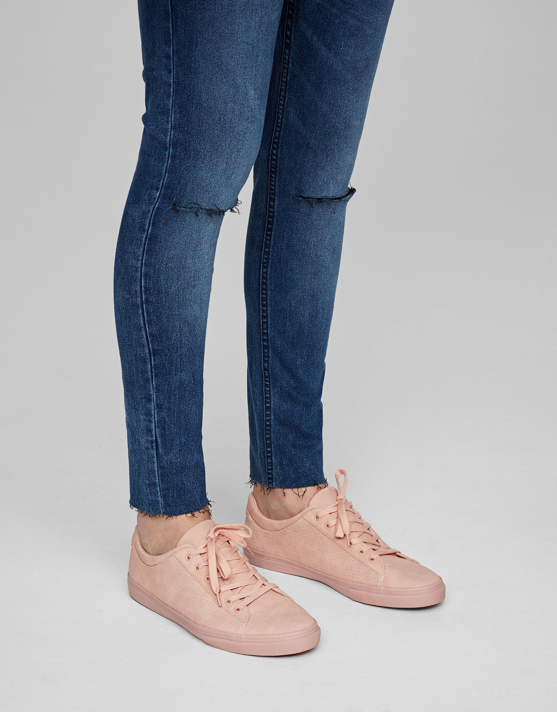 Pink plimsolls with brogueing
