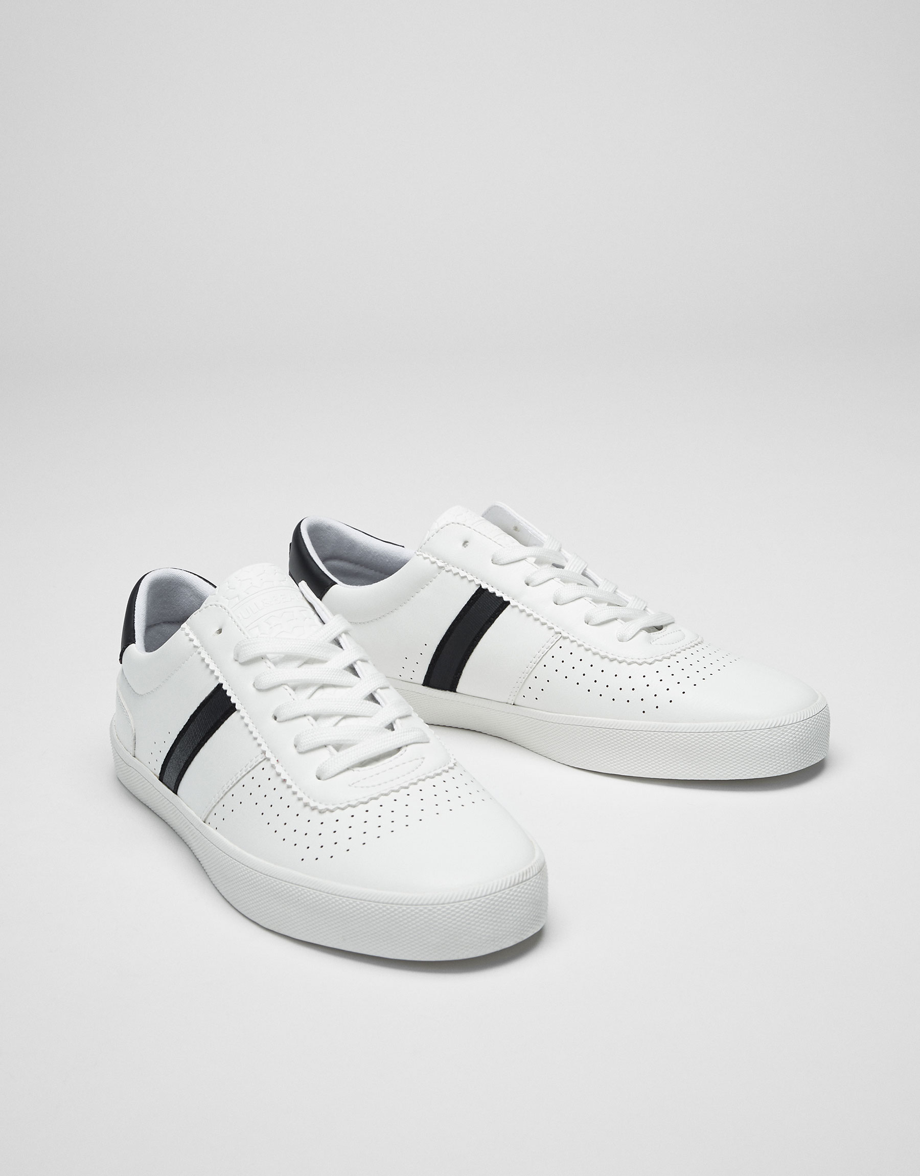 White plimsolls with stripe