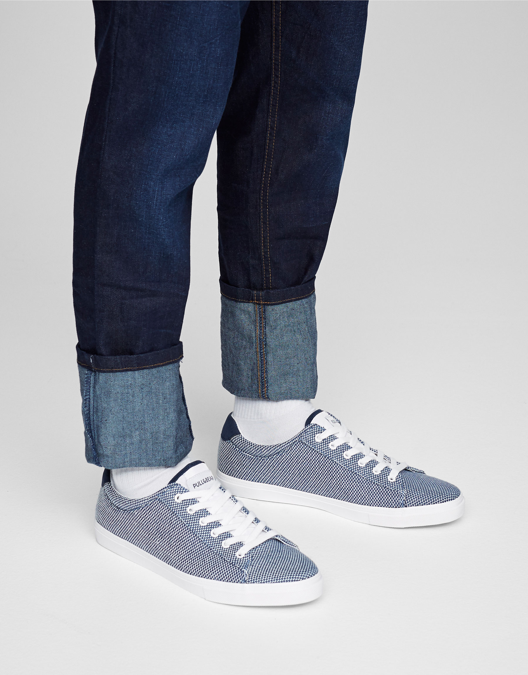 Blue canvas plimsolls