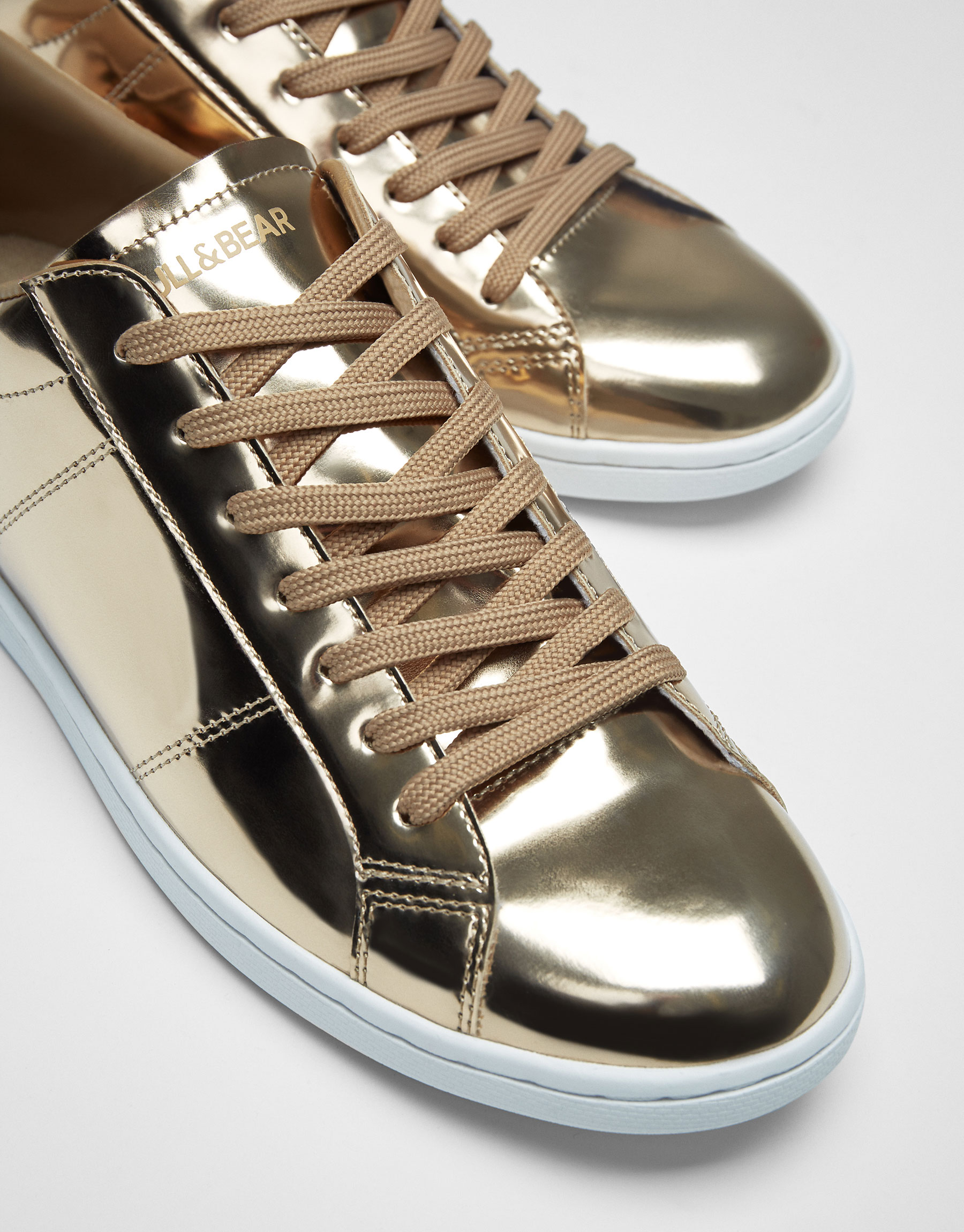 Golden patent finish plimsolls